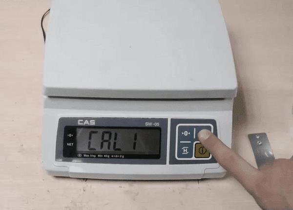 Nhấn nút Tare để chọn hiệu chuẩn cân